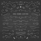 Set of hand drawn flourishes on a chalkboard Stock Photography