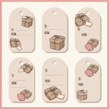 Set with hand drawn gift boxes doodles gift tags. Vector labels collection royalty free illustration