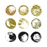 A set of hand drawn glitter, foil brush spots and splashes, ink and paint textures design elements. Gold and Black glittering grungy circles isolated on white Stock Images