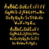 Set of hand drawn glitter golden alphabet in calligraphy brush Royalty Free Stock Photos