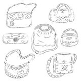 Set of Hand Drawn HandBags. Black Fashion bag silhouettes. Sketch Style. Vector Illustration Royalty Free Stock Photos