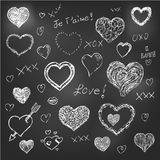 Set of hand drawn hearts on chalkboard background Stock Images