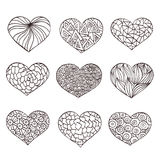 Set of hand drawn hearts. Ornate ink drawing Stock Photos