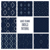 Set of hand drawn indigo blue patterns. Seamless vector native american backgrounds with triangles, arrows, rhombuses Stock Photography