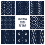 Set of hand drawn indigo blue patterns. Seamless vector tribal indian backgrounds with triangles, arrows, rhombuses and Stock Photos