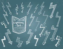 Set of hand drawn lightning on blue background. vector illustration