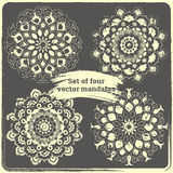 Set of 4 hand drawn mandalas. Vintage style elements with grunge Stock Images