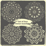 Set of 4 hand drawn mandalas. Vintage style elements with grunge Royalty Free Stock Photography
