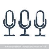 Set of hand-drawn microphone icons, brush drawing multimedia sig Stock Photos