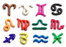 Set of hand drawn modeling clay zodiac signs. Handmade plasticin Stock Image