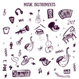 Set of hand drawn Music Instruments in vector with guitar, rock, bass. Doodle mystical items in rough style Royalty Free Stock Images