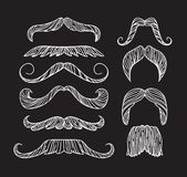 Set of hand drawn old fashion mustaches. Black contour artistic drawing Vector Illustration