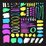 Set of hand drawn paint object for design use. Abstract brush drawing. Set of hand drawn paint object for design use. Acid colors on black background. Abstract Stock Illustration
