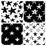 Set of hand drawn paint seamless pattern. Black and white stars background. Abstract brush drawing. Grunge Vector art illustration Vector Illustration