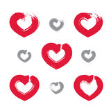 Set of hand-drawn red love heart icons, collection. Of loving heart signs created with real hand-drawn ink brush scanned and vectorized, symmetric hand-painted Royalty Free Illustration