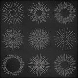 Set of hand drawn retro sunburst, fireworks or bursting rays design elements, stylized drawing with chalk. Grunge Stock Image