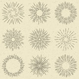 Set of hand drawn retro sunburst, fireworks or bursting rays design elements. Vintage style, grunge paper background. Set of hand drawn retro sunburst Stock Photography