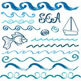 Set of hand drawn sea design elements. Set of hand drawn sea waves and design elements Royalty Free Stock Image