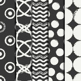 Set of hand drawn seamless pattern with black grunge rings, circle. Wrapping paper. Abstract vector background. Brush Stock Images