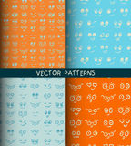 Set of hand drawn seamless patterns with funny faces Royalty Free Stock Photos