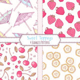 Set of hand drawn seamless patterns with strawberry, cherry, banana and cocktail umbrella. Sweet toppings backgrounds Royalty Free Stock Images