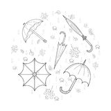 Set of Hand Drawn SKetch autumn umbrellas, leaves, mushrooms and drops arranged in a shape of a circle Royalty Free Stock Photography