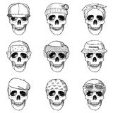 Set of hand drawn skulls with hats Stock Photos