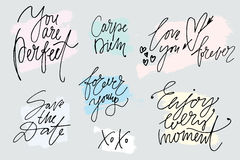 Set of hand drawn slogans with painted strokes on background. Lettering. Phrases and greetings by hand in marker drawn Stock Images
