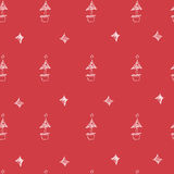Set of hand drawn stars and chrismas tree. Retro vintage style. Seamless background. chrismas pattern on red background. Royalty Free Stock Photo