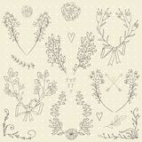 Set of hand drawn symmetrical floral graphic design elements. Stock Photos