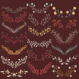 Set of hand drawn symmetrical floral graphic design elements in retro style. Royalty Free Stock Image