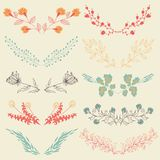 Set of hand drawn symmetrical floral graphic design elements in retro style. Stock Photo