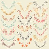 Set of hand drawn symmetrical floral graphic design elements in retro style. Royalty Free Stock Photo
