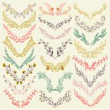 Set of hand drawn symmetrical floral graphic design elements in retro style. Royalty Free Stock Photography