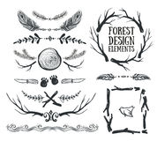 Set of hand drawn tribal frames and dividers. Forest design. Stock Photos