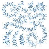 The set of hand drawn vector circular decorative elements for your design. Leaves, swirls, floral elements. Stock Photo