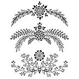 Set of hand drawn vector floral branches Stock Photos