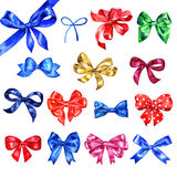 Set of hand drawn watercolor holiday elements with satin bows. Royalty Free Stock Images