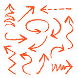 Set of hand drawn wax crayon fun red arrows. Stock Photography
