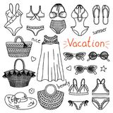 Set of hand drawn women clothes and accessories. Vacation royalty free illustration