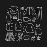 Set of hand drawn women clothes in linear style flat lay / top view Royalty Free Stock Images