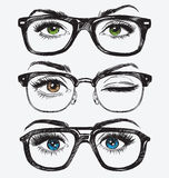 Set of hand drawn women's eyes with hipster glasses.  Stock Images