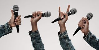 Set of hand holding microphone stock photos