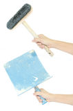 Set of hand holding construction bucket trowel and brush isolated. On white Royalty Free Stock Photos