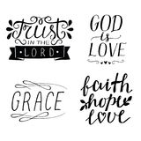 Set of 4 Hand lettering christian quotes God is love. Faith, hope, love. Grace. Trust in the Lord. Royalty Free Stock Photography