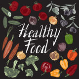 Set of hand painted Healthy Food text and vegetables. Set of hand painted Healthy Food text and vegetables on black background. Great for agriculture Stock Image