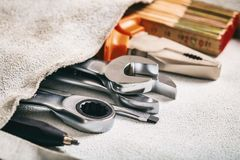 Set of hand tools in a pocket Stock Images