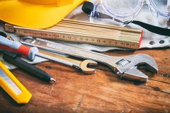 Set of hand tools on wooden background Royalty Free Stock Images