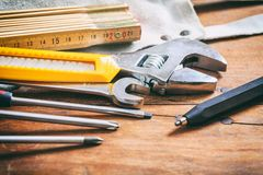 Set of hand tools on wooden background Stock Photos