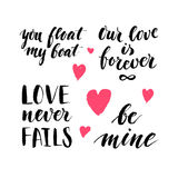 Set of hand written ink quotes and phrases about love witn tiny additional hearts for Valentines Day designs. Stock Images